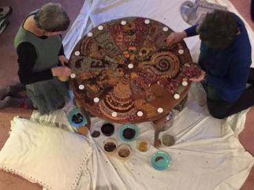 Barbara & Karen work on Solstice mandala